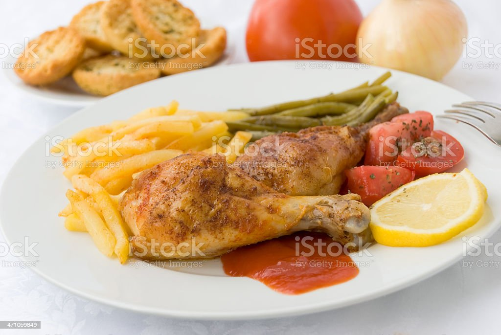 grilled chicken legs with asparagud,fried potatoes royalty-free stock photo