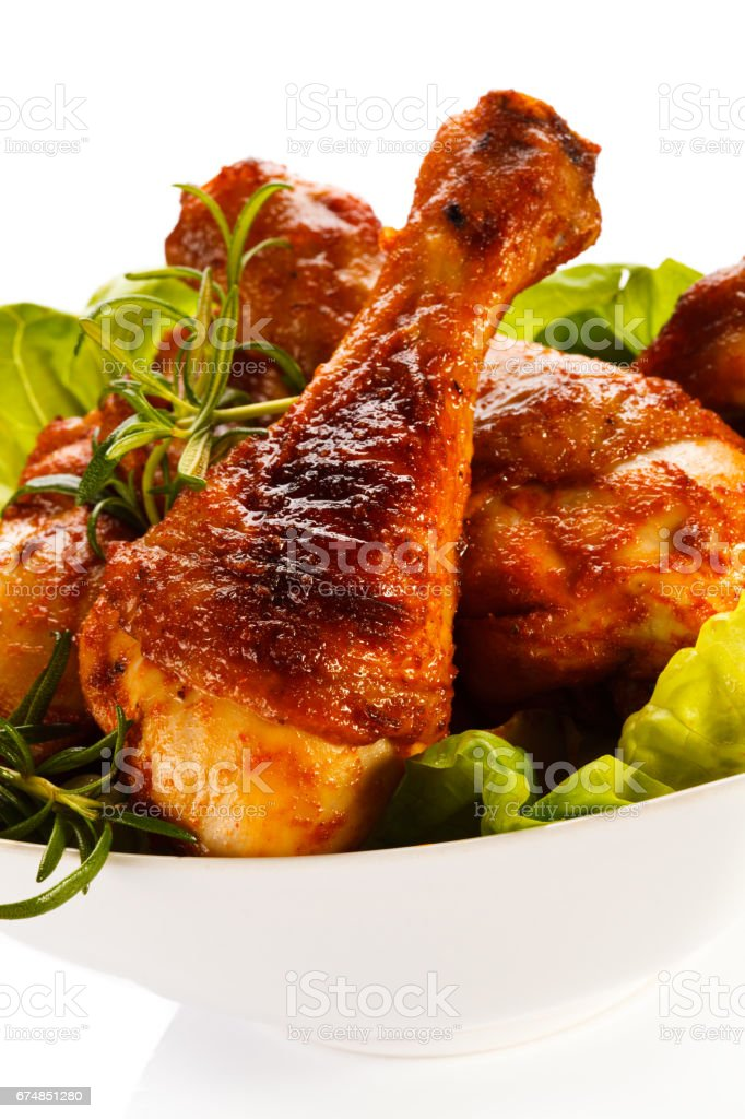 Grilled chicken legs with chips and vegetables stock photo