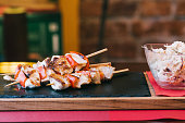 Grilled chicken meat on a skewer