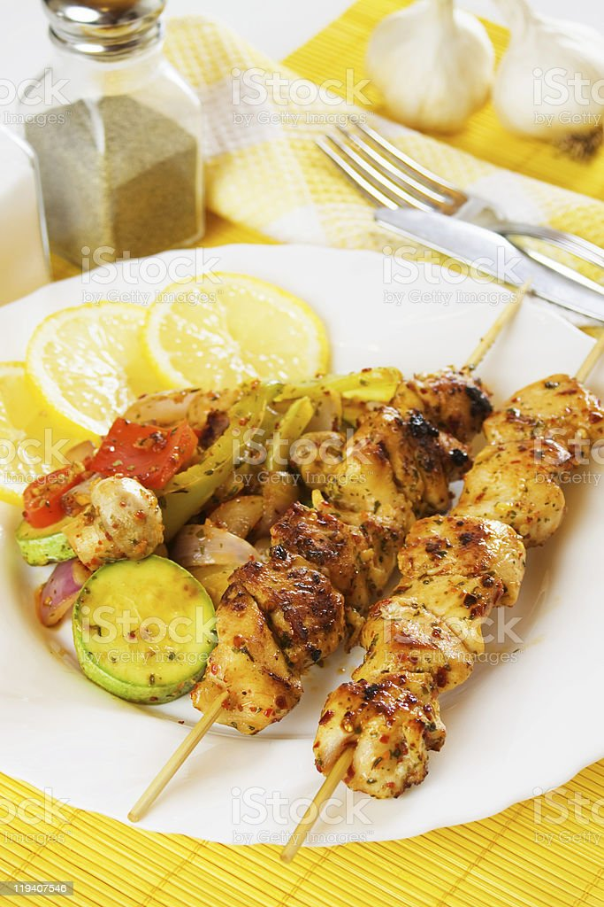 Grilled chicken meat on skewer royalty-free stock photo