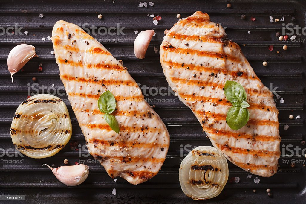Grilled chicken on the grill close up horizontal top view stock photo