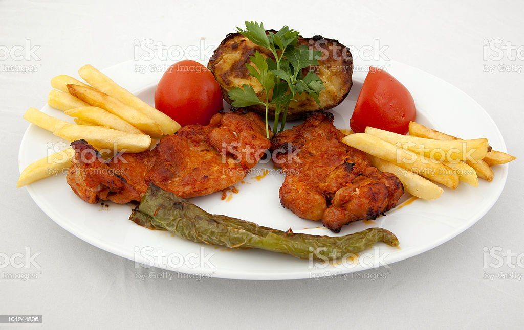Grilled chicken on white isolated background royalty-free stock photo