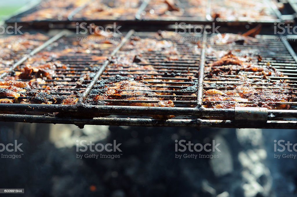 BBQ Grilled Chicken over fire pit stock photo