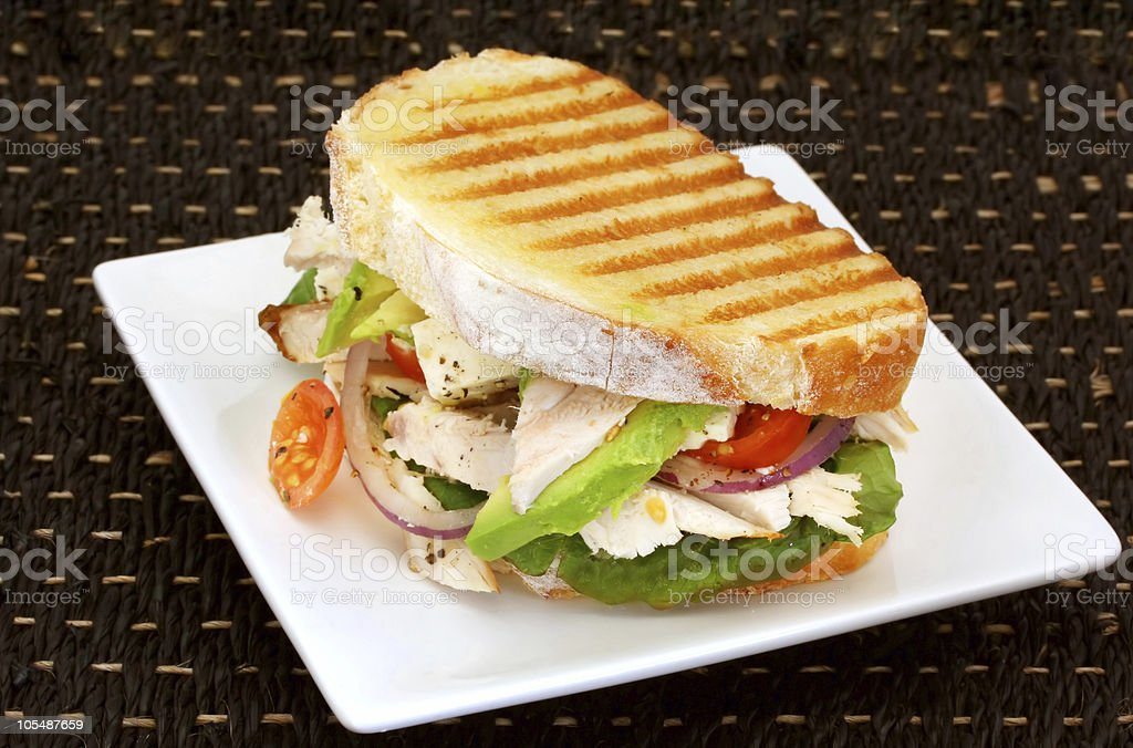 Grilled chicken panini with lettuce and tomato stock photo