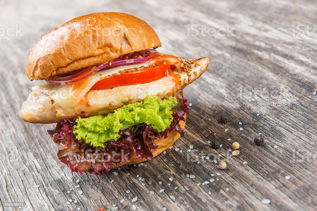 Grilled chicken sandwich with red onions stock photo