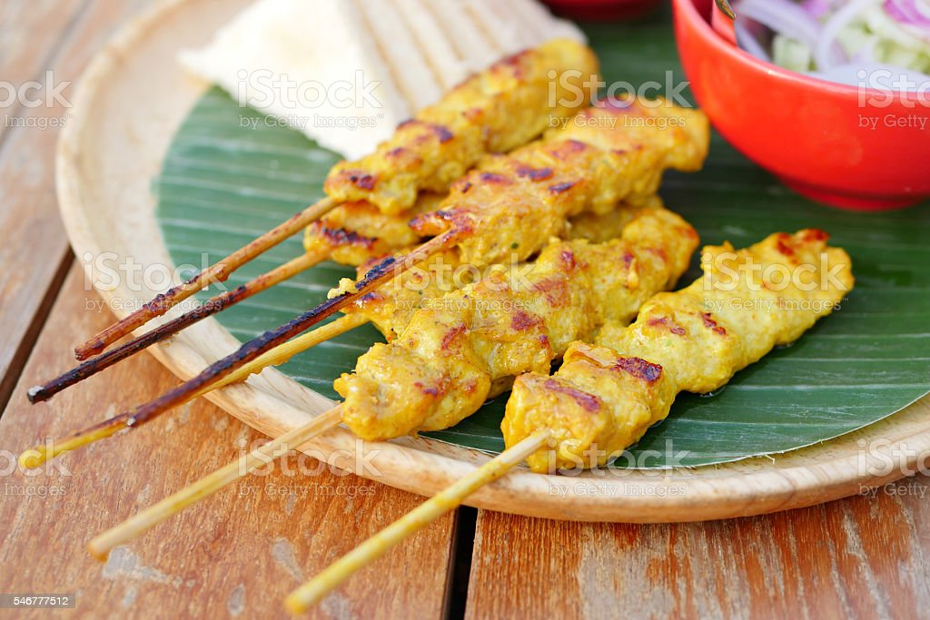 grilled chicken satay with dipping sauce and side dish stock photo