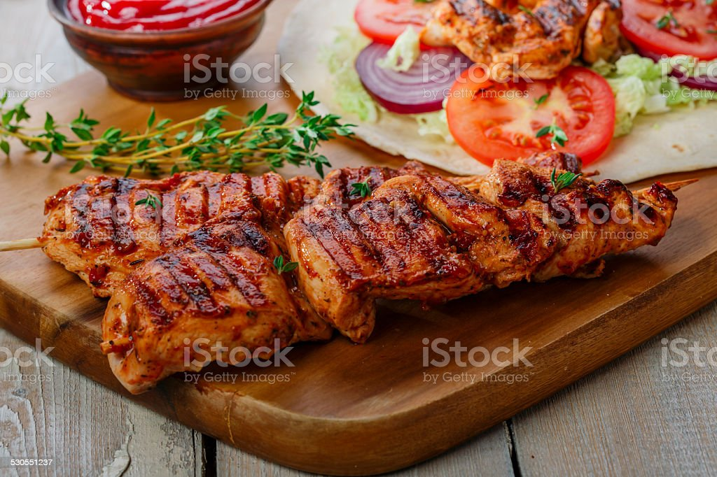 grilled chicken shawarma with sauce stock photo