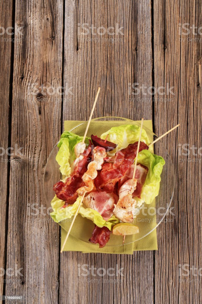 Grilled chicken skewers and bacon royalty-free stock photo