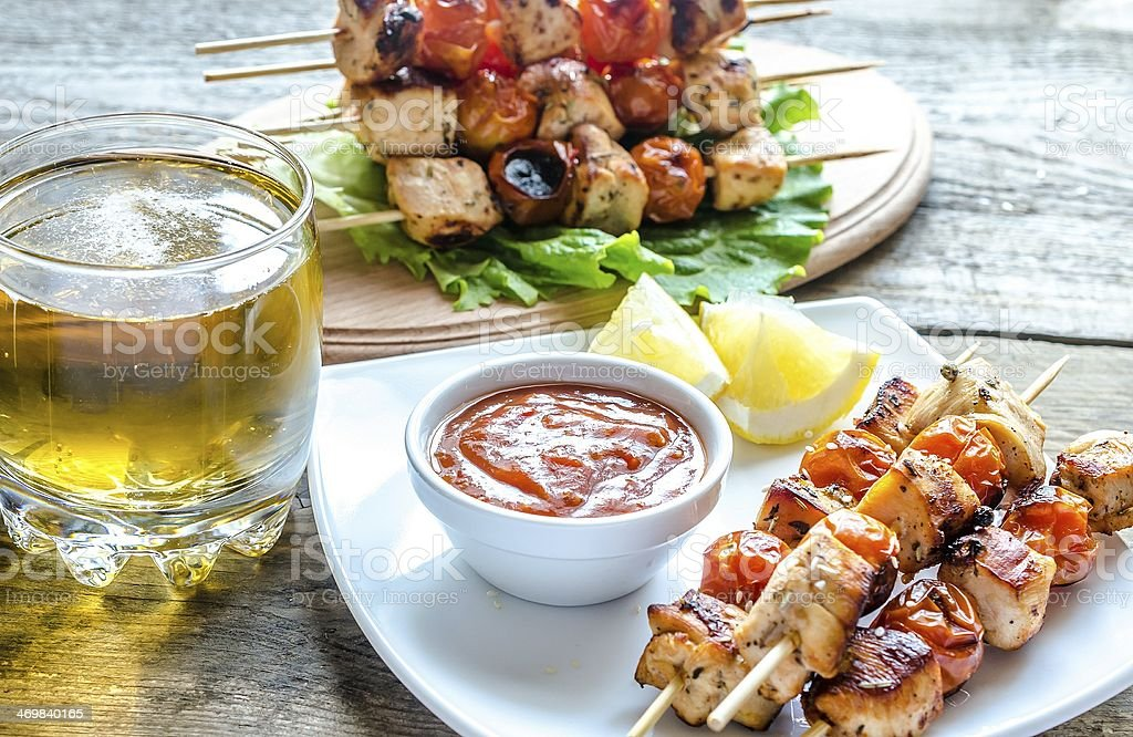 Grilled chicken skewers with cherry tomatoes royalty-free stock photo