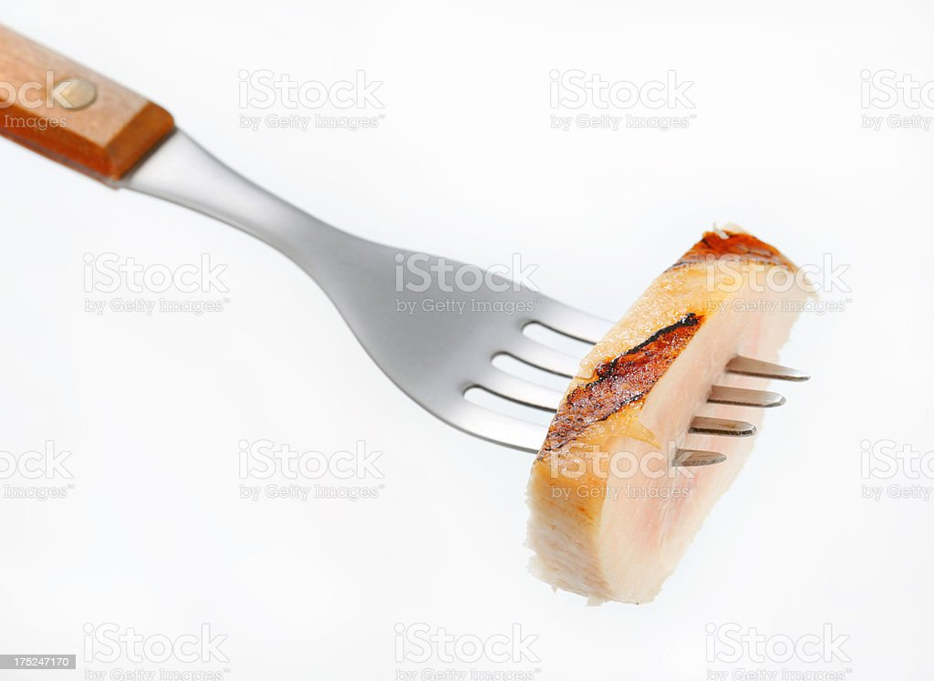 grilled chicken slice on a fork royalty-free stock photo