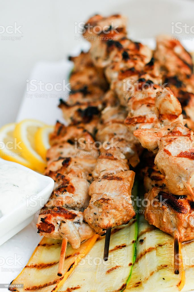 Grilled chicken souvlaki skewers stock photo