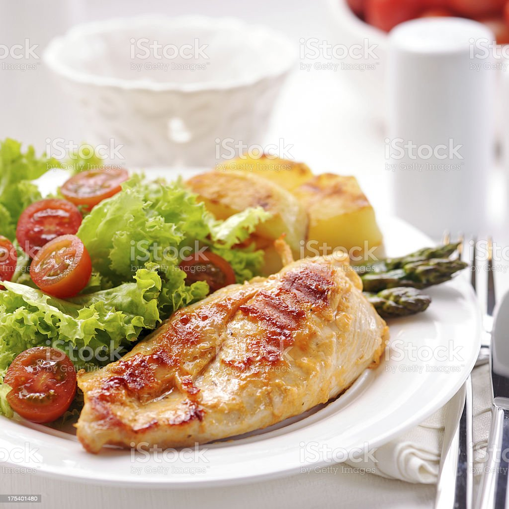 Grilled chicken steak with potatoes,asparagus and salad royalty-free stock photo