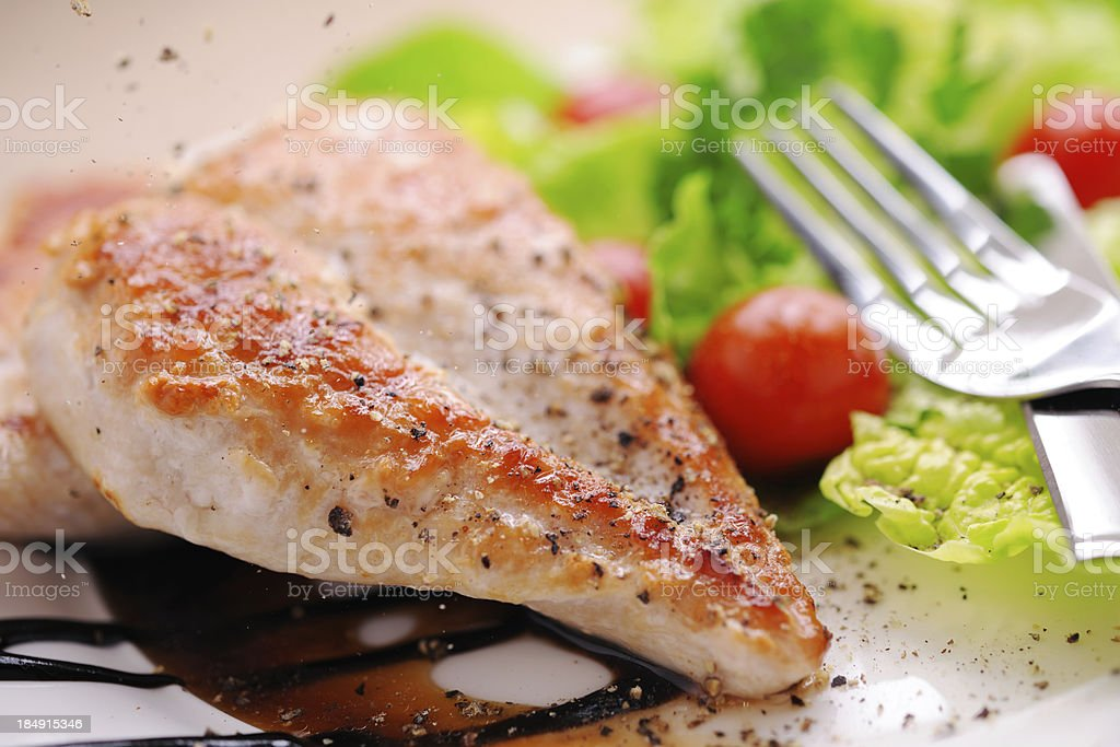 Grilled chicken steak with salad and balsamic vinegar royalty-free stock photo