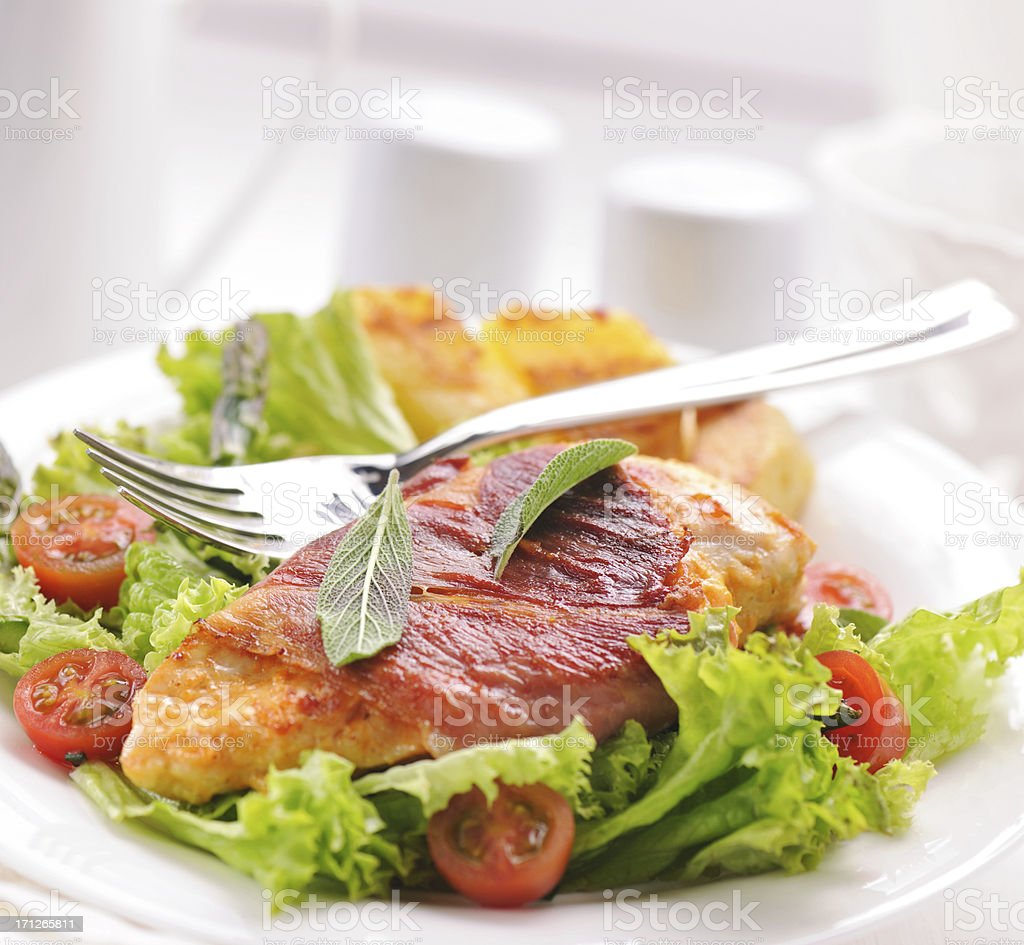 Grilled chicken steak wrapped with ham and sage royalty-free stock photo