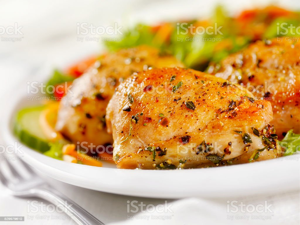 Grilled Chicken Thighs with a side Salad stock photo