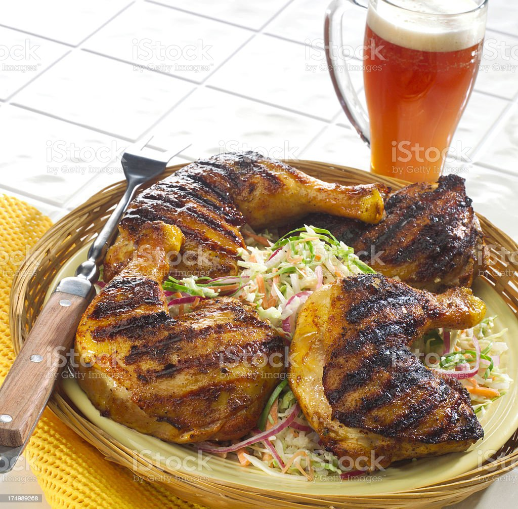Grilled Chicken thighs with slaw stock photo