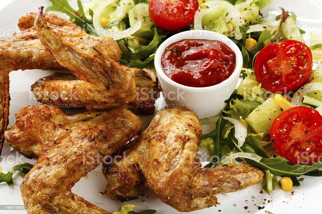 Grilled chicken wings and vegetables royalty-free stock photo