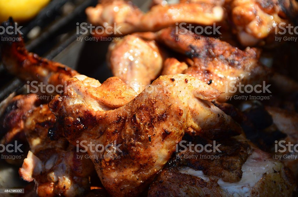 Grilled chicken Wings on the grill stock photo