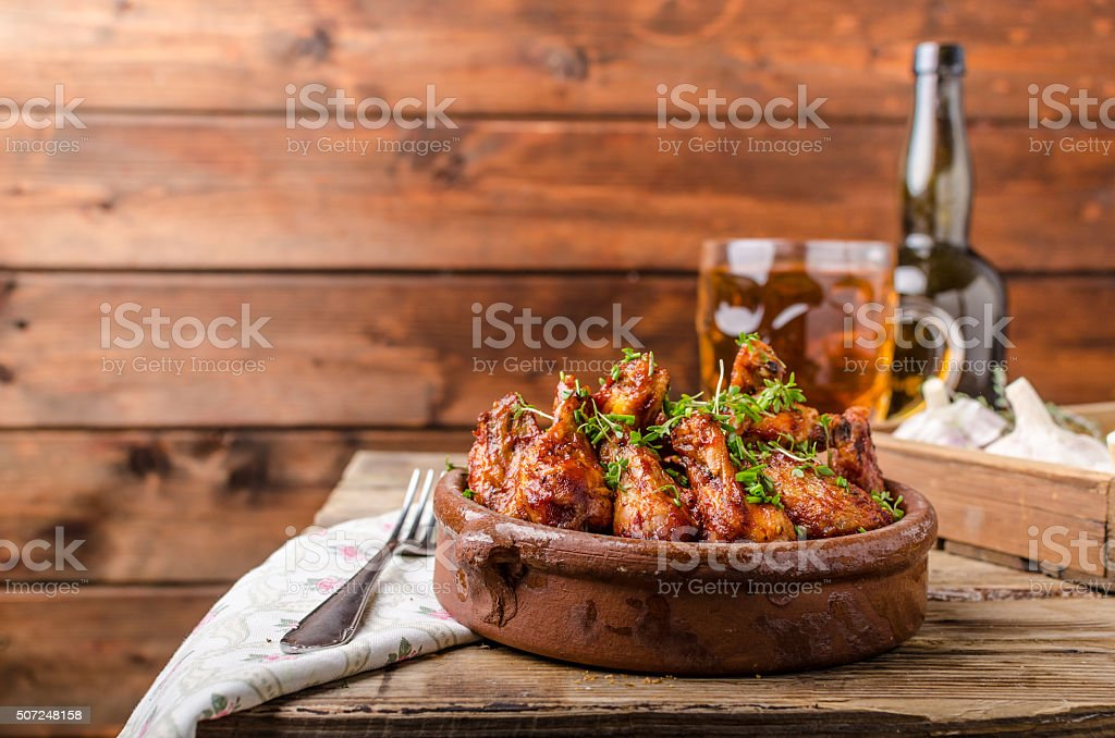 Grilled chicken wings with beer stock photo