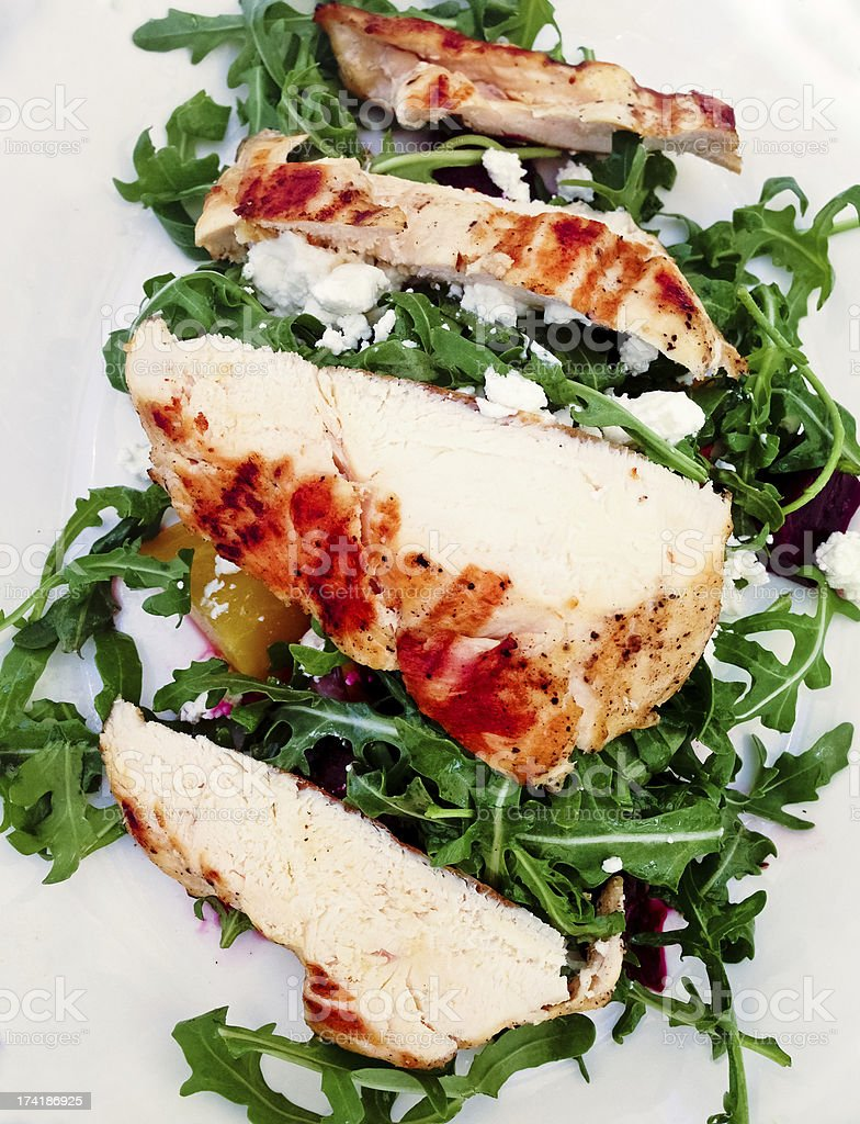 Grilled chicken with beets and arugula salad royalty-free stock photo