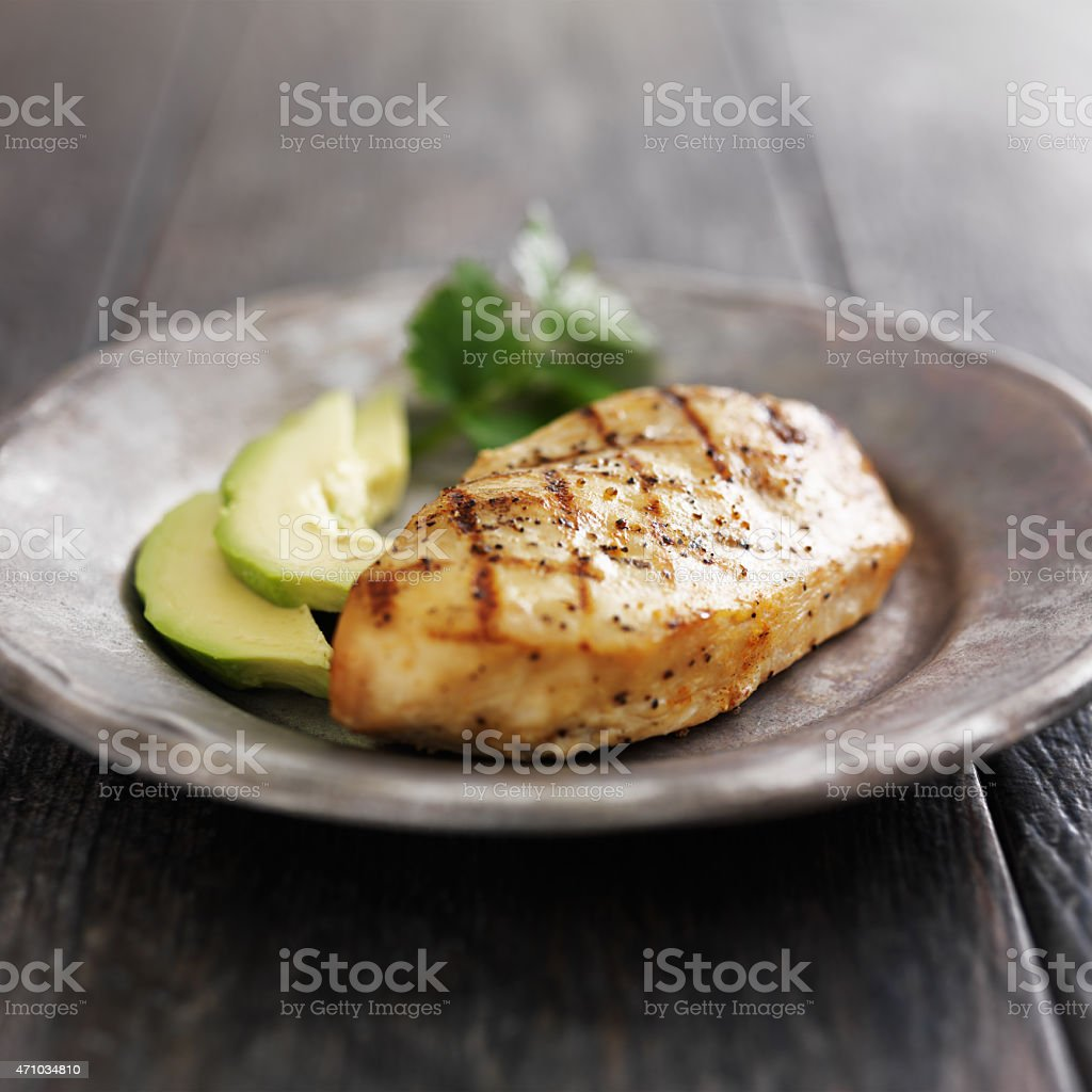 grilled chicken with cilantro and avocado stock photo