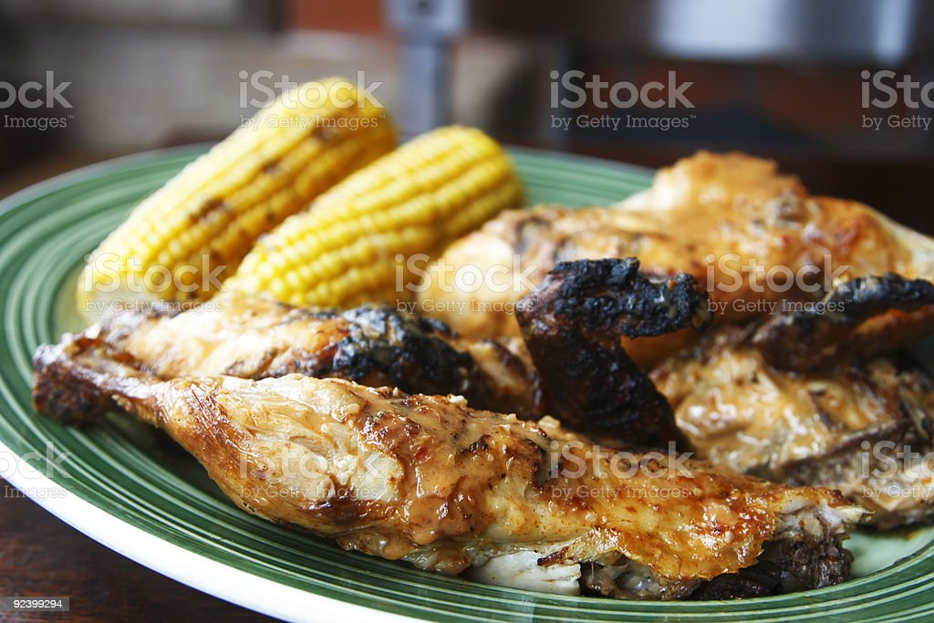 grilled chicken with corn cobs on background royalty-free stock photo