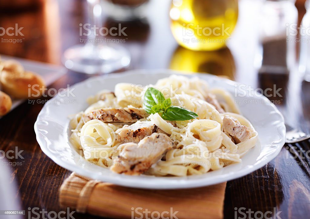 grilled chicken with fettuccine alfredo pasta stock photo