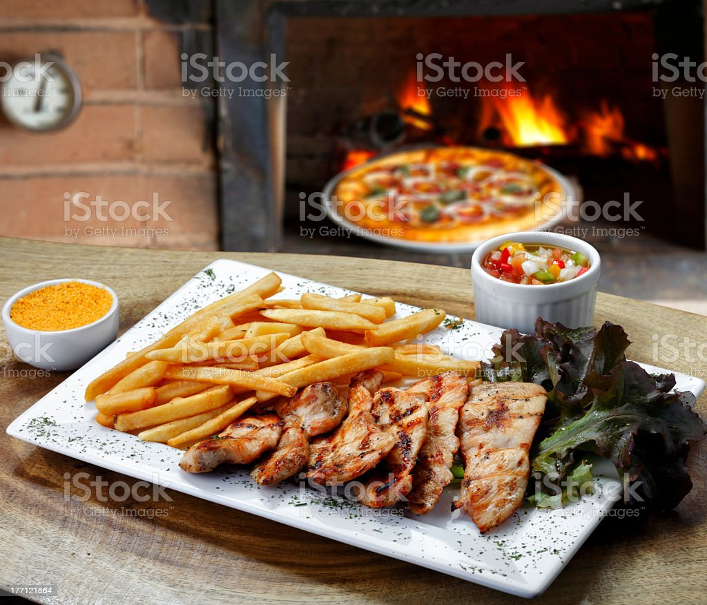 Grilled chicken with french fries royalty-free stock photo