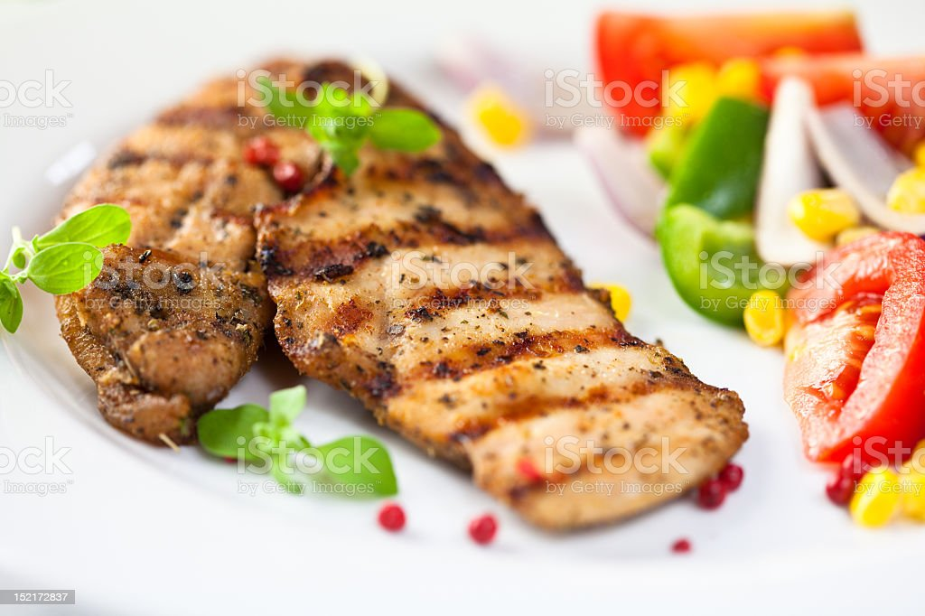 Grilled chicken with fresh vegetables royalty-free stock photo