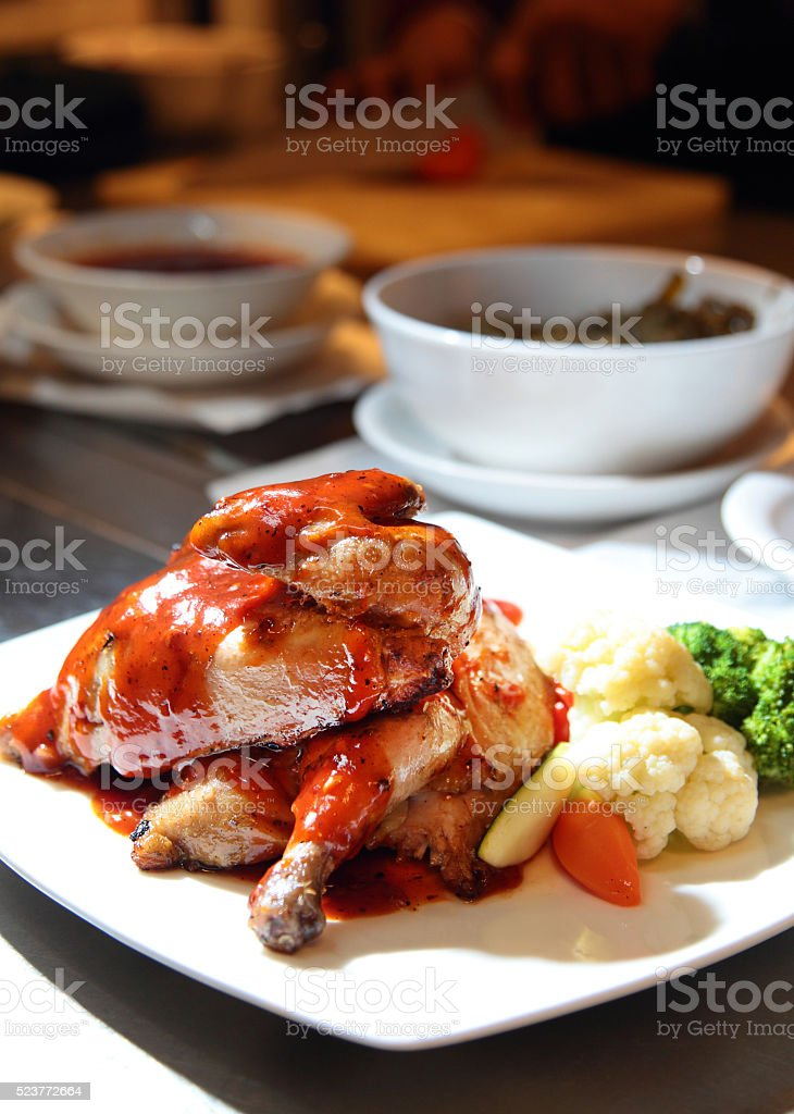 Grilled chicken with Sauce stock photo