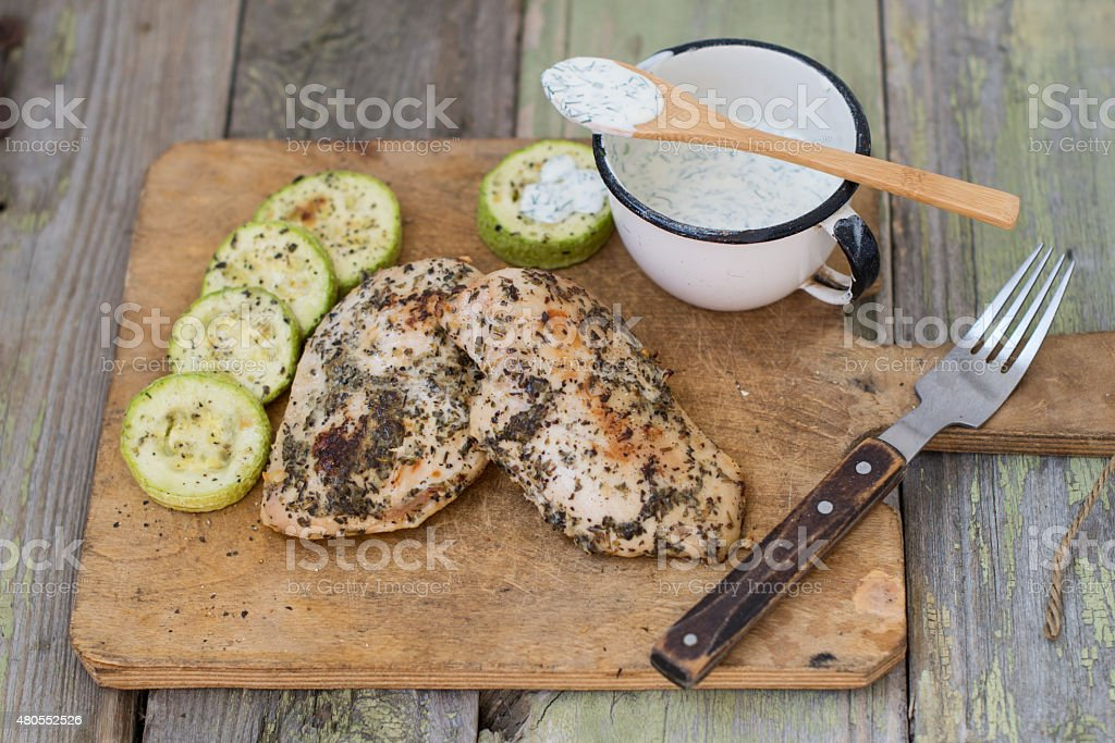 Grilled chicken with tzatziki sauce stock photo
