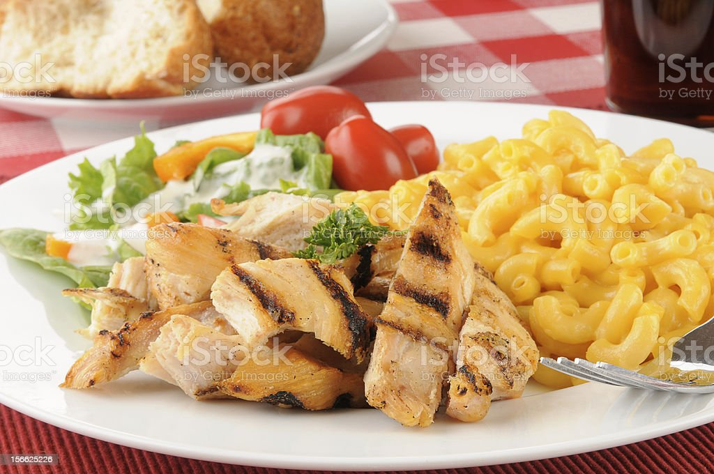 Grilled chicken withh macaroni and cheese royalty-free stock photo