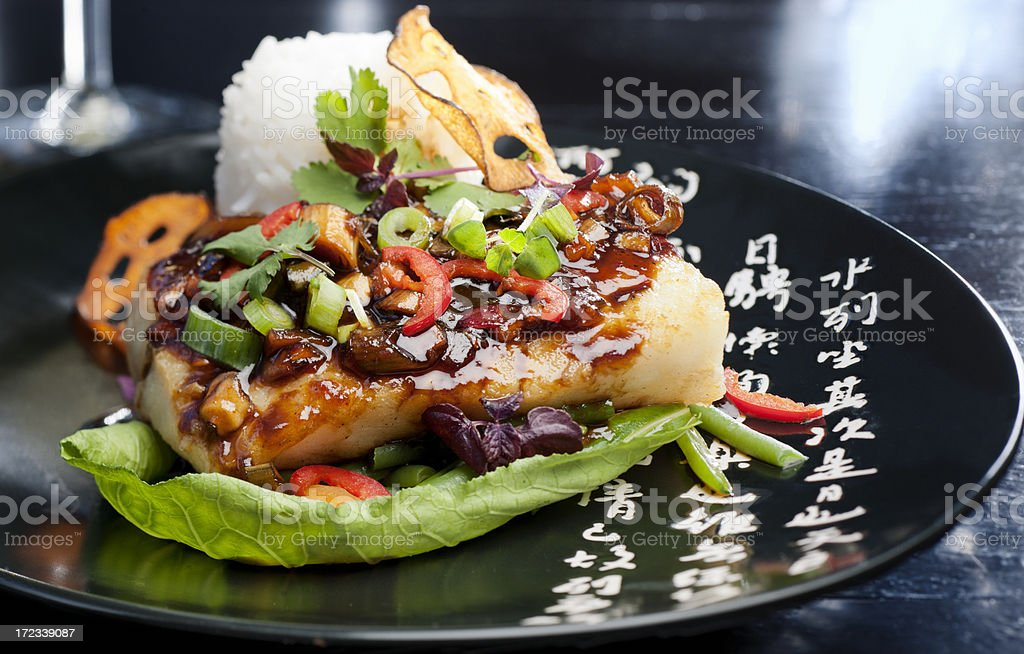 grilled cod fillet on stir-fried vegetables and boiled white rice royalty-free stock photo