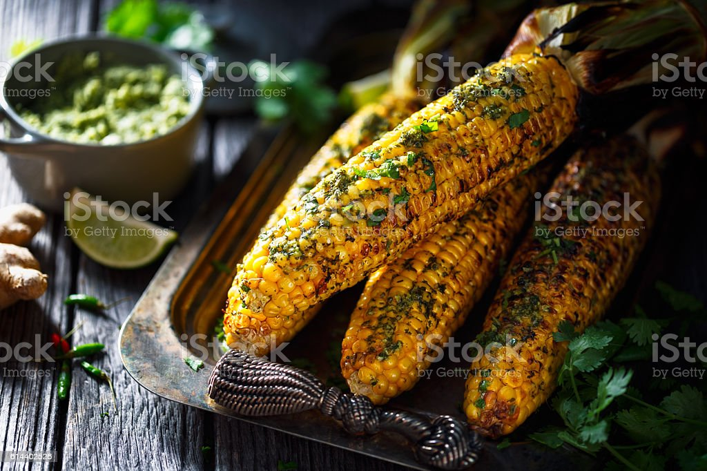 grilled corn on cob stock photo