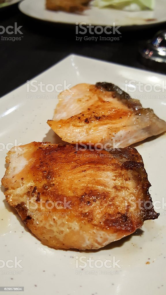 grilled delicious salmon on white plate stock photo