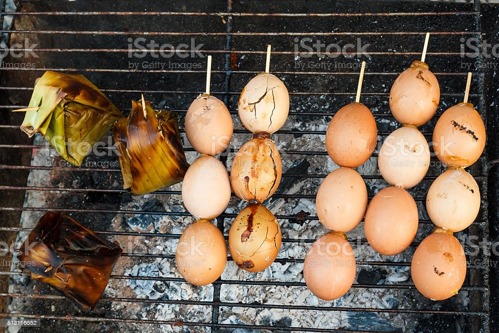 Grilled eggs in stick. stock photo