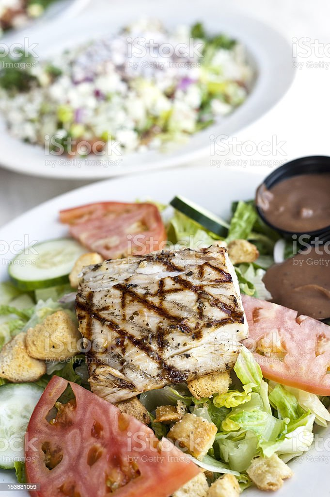 Grilled filled of fish with salad royalty-free stock photo