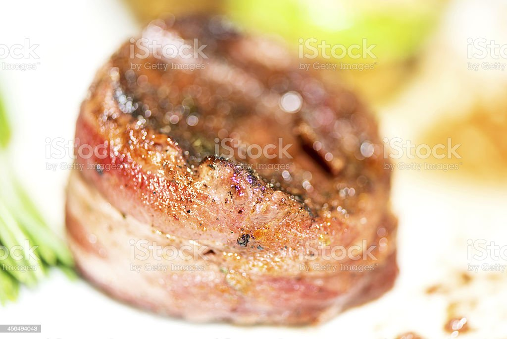 grilled fillet mignon wrapped in bacon macro stock photo