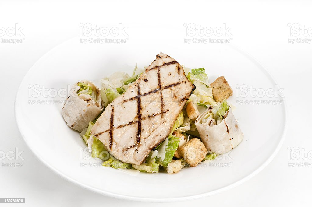 Grilled Fillet of Fish over caesar salad royalty-free stock photo
