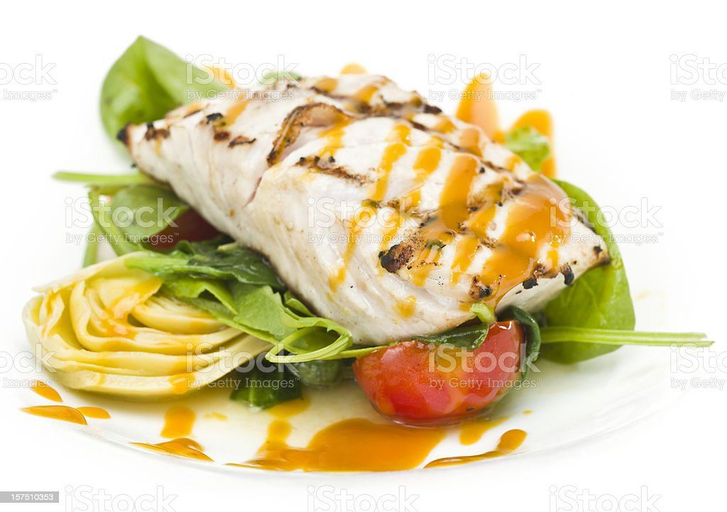 Grilled fillet of fish with artichokes stock photo