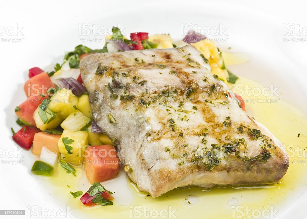 Grilled Fillet of Fish with tropical fruits stock photo