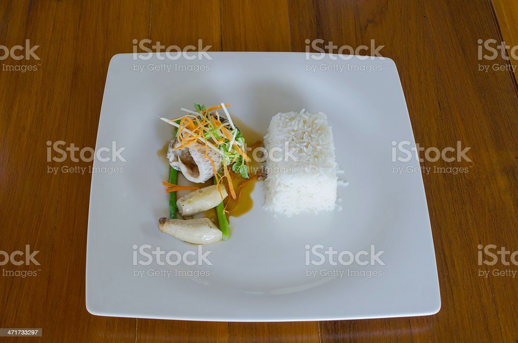 grilled fillet of seabass with teriyaki sauce and stream rice royalty-free stock photo