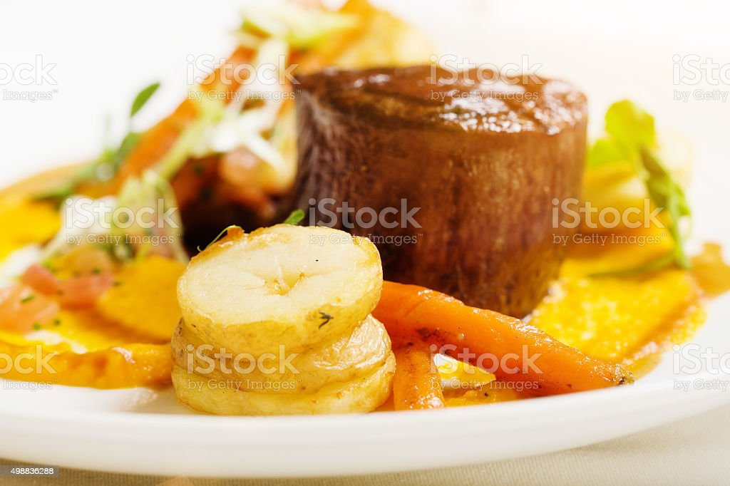 Grilled fillet steak and saute potatoes, the gourmet restaurant version stock photo