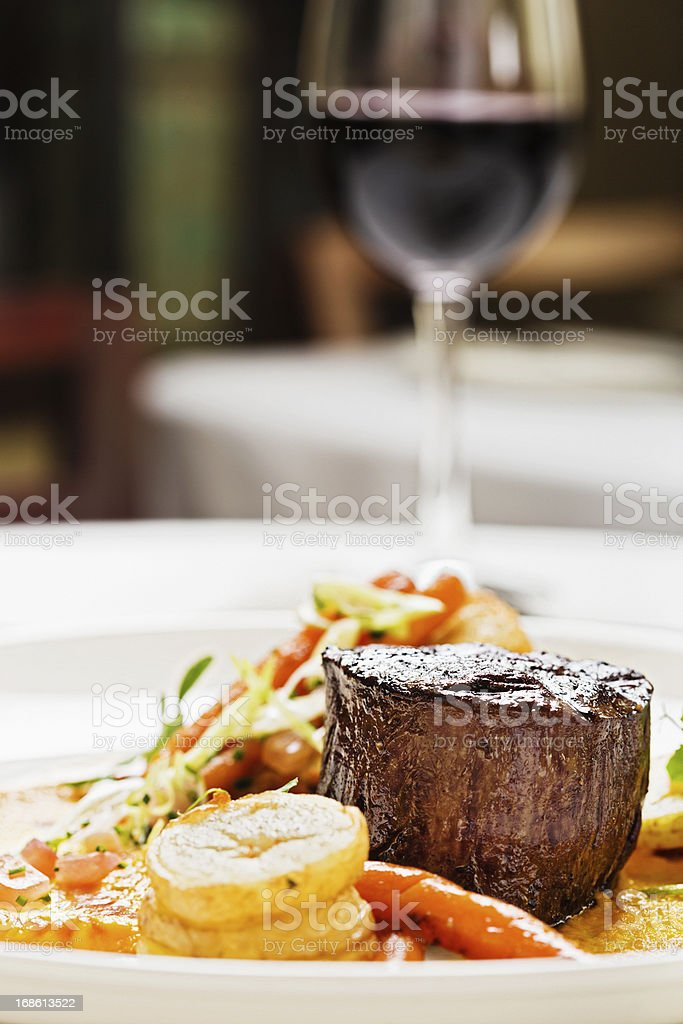 Grilled fillet steak, vegetables, red wine: the perfect restaurant meal royalty-free stock photo