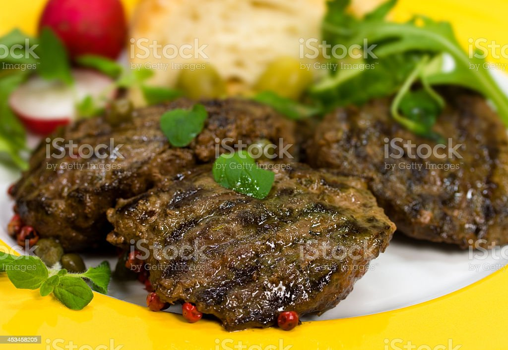 Grilled Fillet-Sirloin of Lamb,with arugula and baguette stock photo