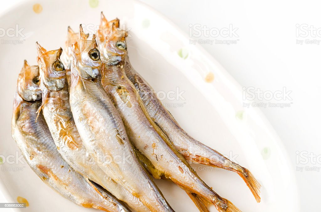 Grilled fish capelin on plate stock photo