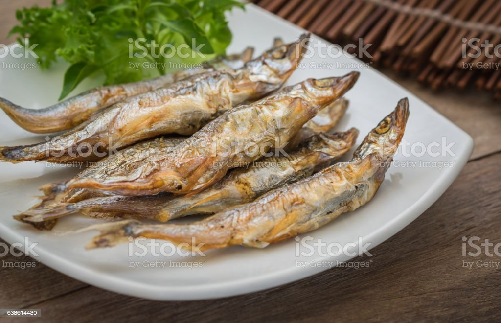 Grilled fish capelin or shishamo on plate stock photo