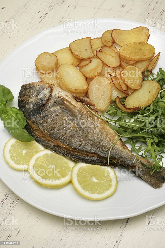 grilled fish eith potato royalty-free stock photo