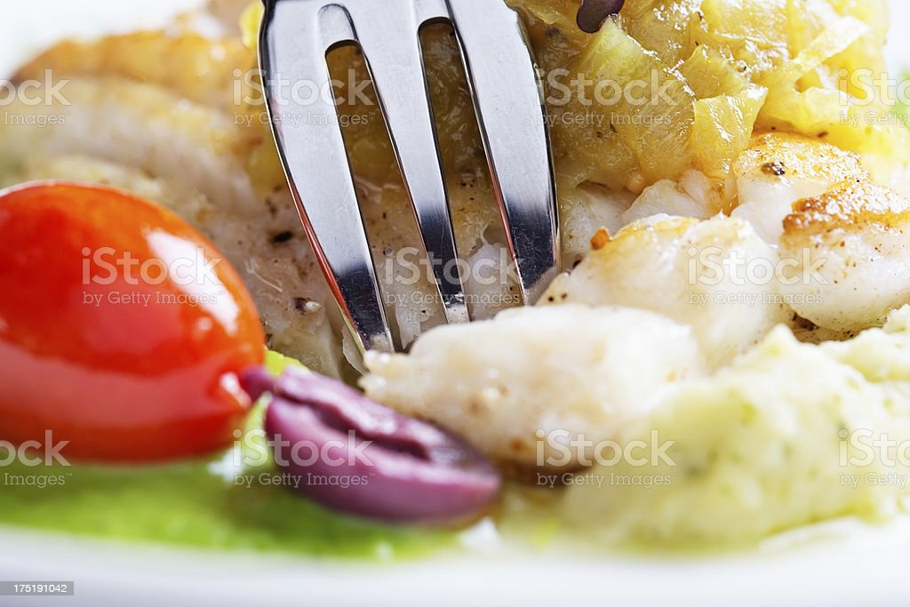 Grilled fish in close up with vegetable accompaniments stock photo