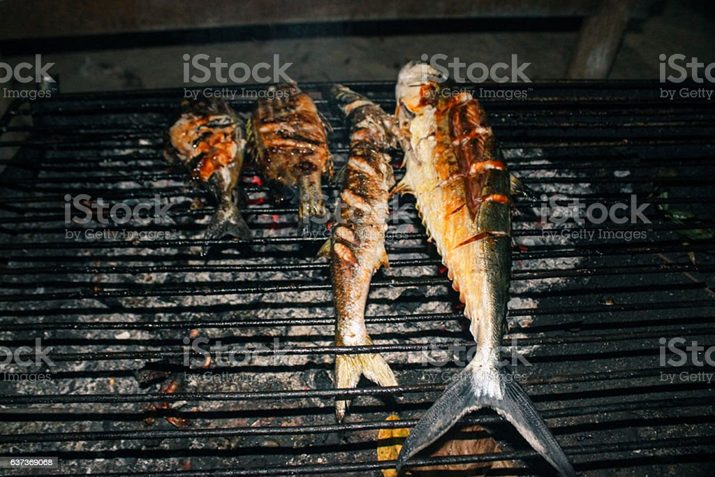 Grilled fish on barbecue grill stock photo